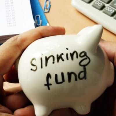 Create a sinking fund to avoid taking up new debt.