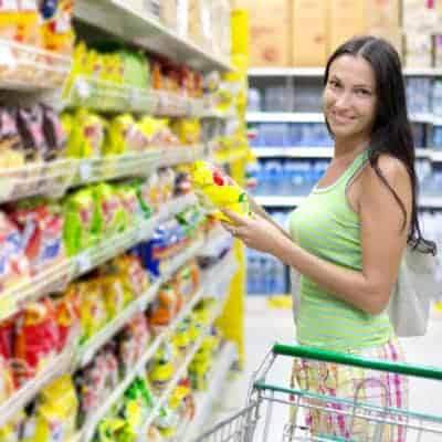 Woman shopping for generic snacks.