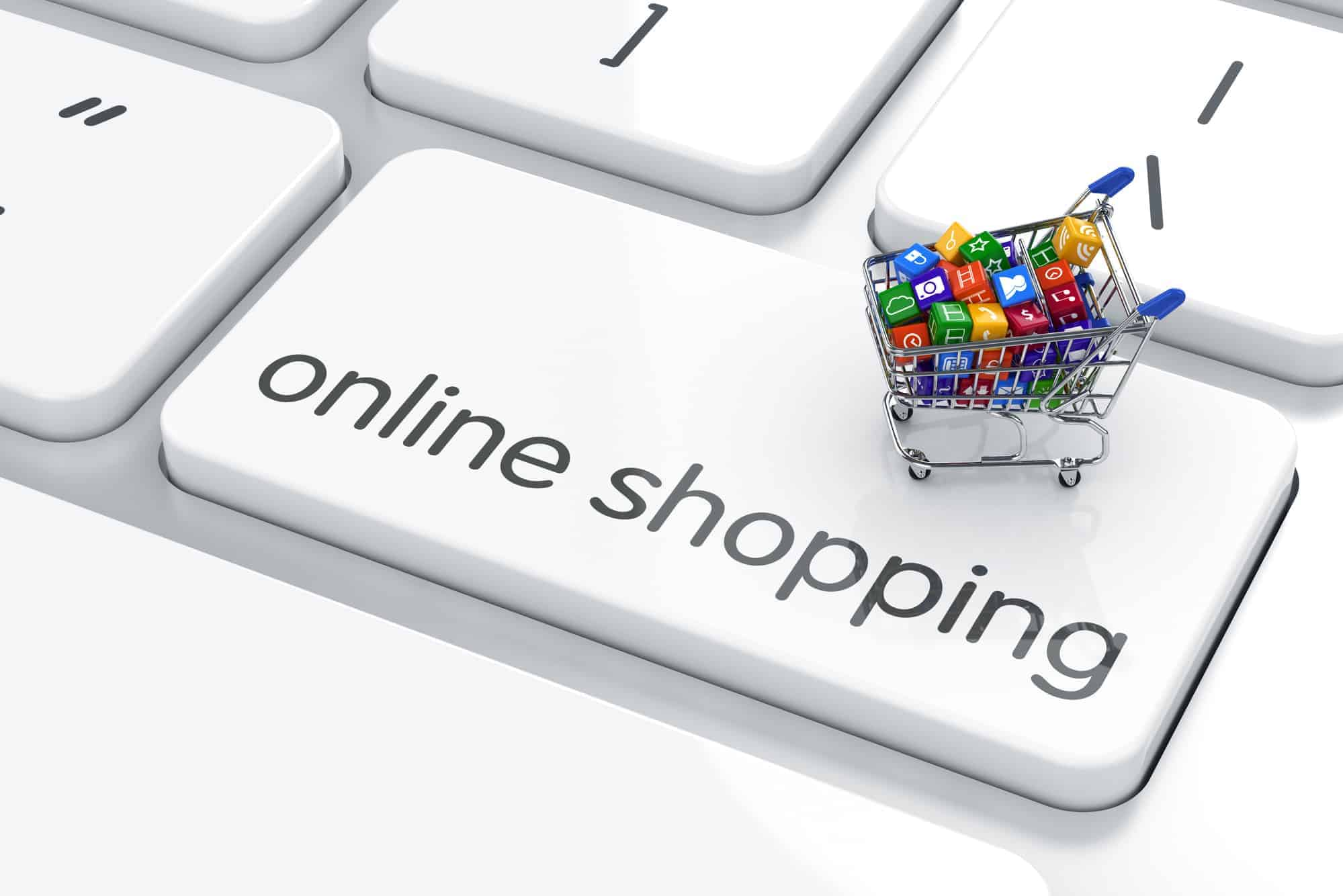 Shopping cart isolated on the computer keyboard. Online shopping concept